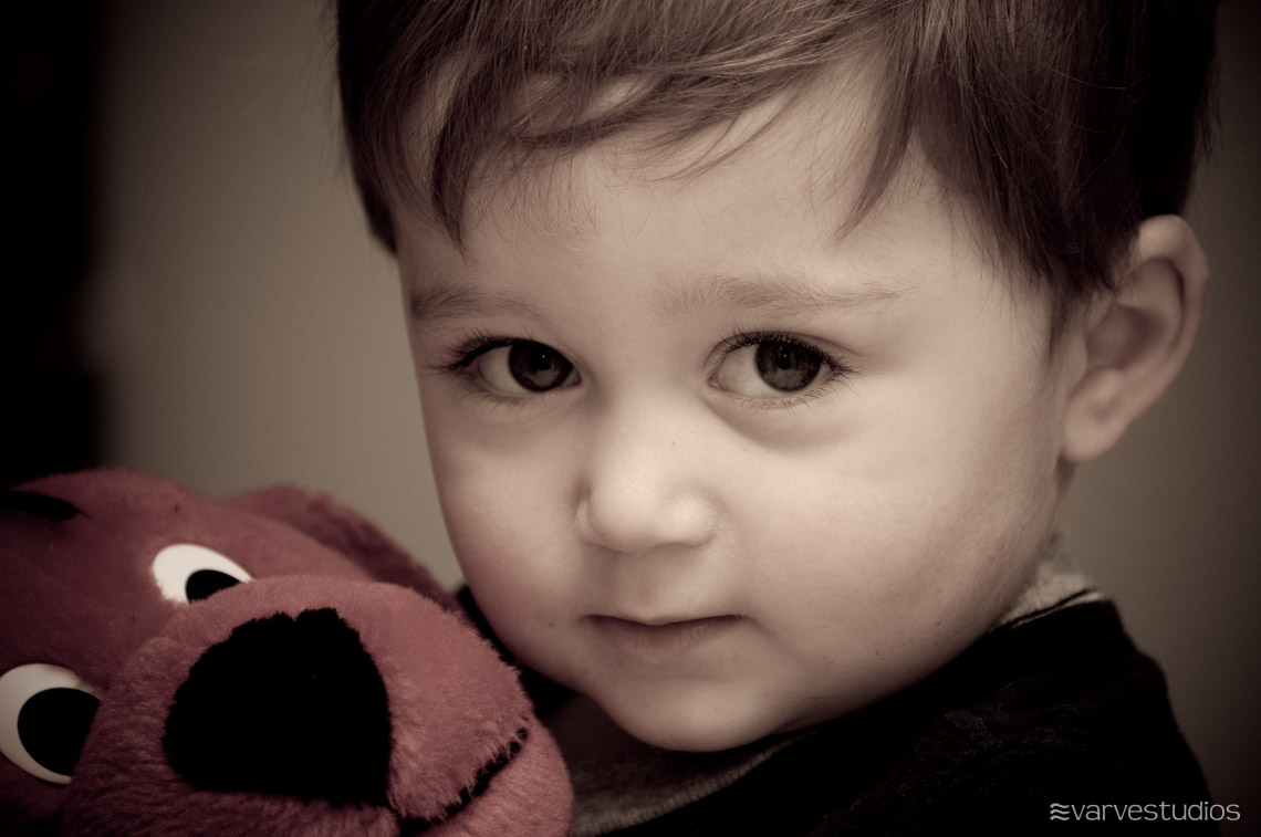 boy and stuffed animal toy