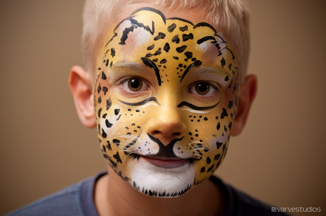 golden leopard face painting